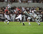 Alabama wide receiver Kenny Bell (7) is tackled by Ole Miss defensive back Cody Prewitt (25) and Ole Miss defensive back Senquez Golson (21) at Bryant-Denny Stadium in Tuscaloosa, Ala. on Saturday, September 29, 2012. Alabama won 33-14. Ole Miss falls to 3-2.