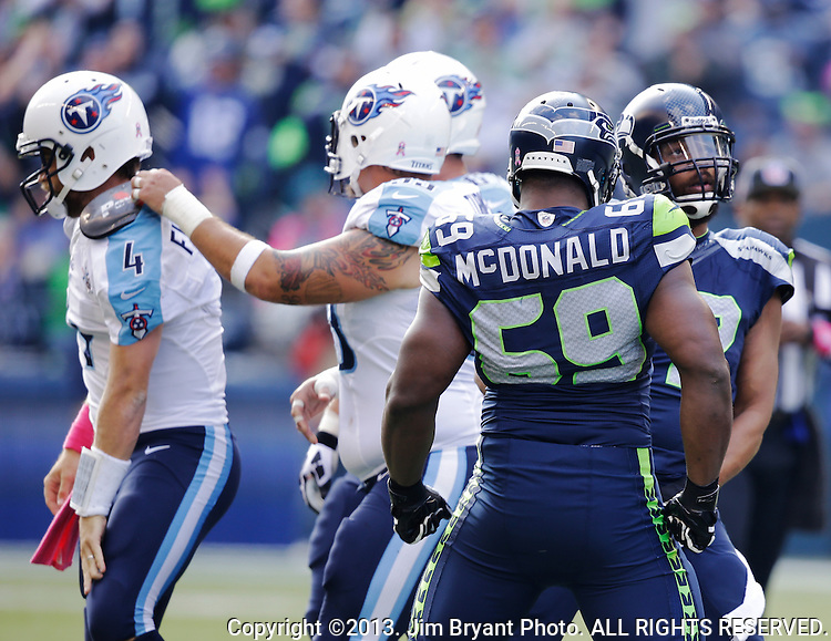 Seattle Seahawks defensive tackle Clinton McDonald (69) celebrates with defensive end Michael Bennett(72) after Bennett sacked Tennessee Titians quarterback Ryan Fitzpatrick (4)  at CenturyLink Field in Seattle, Washington on  November October 13, 2013. The Seattle Seahawks beat the Titians  20-13.   ©2013. Jim Bryant Photo. All Rights Reserved.