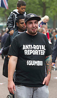 An Australian Tourist with Ant-Royal T-shirt walks down the mall after Princess Kate and Prince William drive to the Buckingham Palace. .Picture: Maurice McDonald/Universal News And Sport (Europe).29 April 2011..