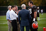 Republican vice presidential candidate Rep. Paul Ryan, left, talks with Cleveland Browns player Joe Thomas, right, on the Cleveland Browns practice field in Berea, Ohio, October 17, 2012.