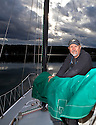 WA09119-00...WASHINGTON - Terry Donnelly sailing the waters off Vashon Island in the Puget Sound. (MR# D13)