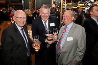Enjoying the party are Richard Bonnello (left) of RWB Chartered Accountants, Gateley's Austin Moore and Colin Watkin of Swissco Investments