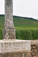 Romanee Conti Vineyard. Base of the stone cross with inscription, erected 1723. Vosne Romanee, Cote de Nuits, d'Or, Burgundy, France