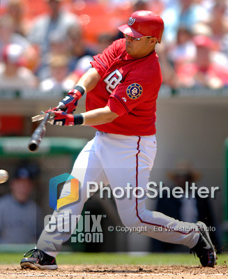 17 June 2006: Jose Vidro (left), second baseman for the Washington Nationals, breaks his bat during a game against the New York Yankees at RFK Stadium, in Washington, DC. The Nationals overcame a seven run deficit to win 11-9 in the second game of the interleague series...Mandatory Photo Credit: Ed Wolfstein Photo...