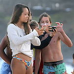 "A group of teen-ages ""chimped"" there photographs they took on your camera=phone at Sandy Beach in Honolulu, HI."