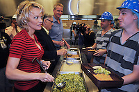 Phoenix, Arizona -- Actress Pamela Anderson talks to a jail inmate after serving him a meal. Anderson visited the Lower Buckeye County Jail in Phoenix, Arizona to promote all-vegetarian meals for inmates. Anderson visited the detention facilities as a spokesperson for People for the Ethical Treatment of Animals (PETA). The actress was given a tour of the facilities by Maricopa County Sheriff Joe Arpaio.  Anderson was accompanied by PETA Senior Vice President Dan Mathews. Photo by Eduardo Barraza © 2015