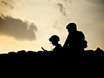 Two soldiers on a PB roof in afghanistan