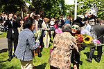 05/19/2013 - Medford, MA - Melissa Cheong receiveds a hug from her grandmother Soon-Teck Cheong at the conclusion of Sunday morning's Tufts University 157th Commencement ceremony held on the Medford/Somerville campus, on May 19, 2013. (Matthew Modoono for Tufts University)
