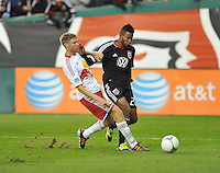 D.C. United forward Lionard Pajoy (26) goes against New York Red Bulls defender Marcus Holgersson (5)  The New York Red Bulls tied D.C. United 1-1 in the first leg of the Eastern Conference semifinals at RFK Stadium, Saturday November 3, 2012.