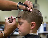 A young boy gets his hair cut by a barber in Westerville, Ohio.<br />