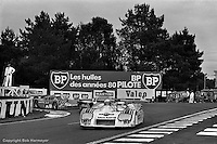 LE MANS, FRANCE: The Lancia Martini LC1 001003 driven by Hans Heyer, Riccardo Patrese and Piercarlo Ghinzani leads a group of cars through the Mulsanne Corner during the 24 Hours of Le Mans on June 20, 1982, at Circuit de la Sarthe in Le Mans, France.