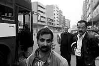 Baghdad, Iraq, Feb 21, 2003.A bus stop in Al Jumurryah street..As the menace of an American military intervention becomes more precise, tension shows on the faces of the people of Baghdad.
