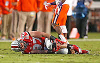 Ohio State Buckeyes defensive lineman Joey Bosa (97) holds his injured knee in the first half of the 2014 Discover Orange Bowl at Sun Life Stadium in Miami Gardens, Florida on January 3, 2014. (Chris Russell/Dispatch Photo)