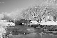 Rural Kentucky bridge over flowing creek in Winter.  Infrared (IR) photograph by fine art photographer Michael Kloth.