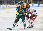 ST CHARLES, MO - MARCH 19:  Kelly Mariani (26) of the Clarkson Golden Knights jockeys for position with Jenny Ryan (5) of the Wisconsin Badgers during the Division I Women's Ice Hockey Championship held at The Family Arena on March 19, 2017 in St Charles, Missouri. Clarkson defeated Wisconsin 3-0 to win the national championship. (Photo by Mark Buckner/NCAA Photos via Getty Images)