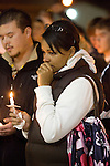 Stephanie James, right, grieves during a light prayer vigil at the Champion's Centre in Tacoma WA., for family members, friends and law enforcement officers for four Lakewood Police officers killed at a Lakewood coffee shop on Sunday, Nov. 29, 2009.  At about 8:00 a.m. Sunday morning, a gunman walked into the Forza Coffee shop and while the four police officers were having coffee before their shift started, he opened fire, killing all four law enforcement officers. James, who's husband is also a Lakewood poice officer knew the police officers killed. Jim Bryant Photo. ©2010. ALL RIGHTS RESERVED.