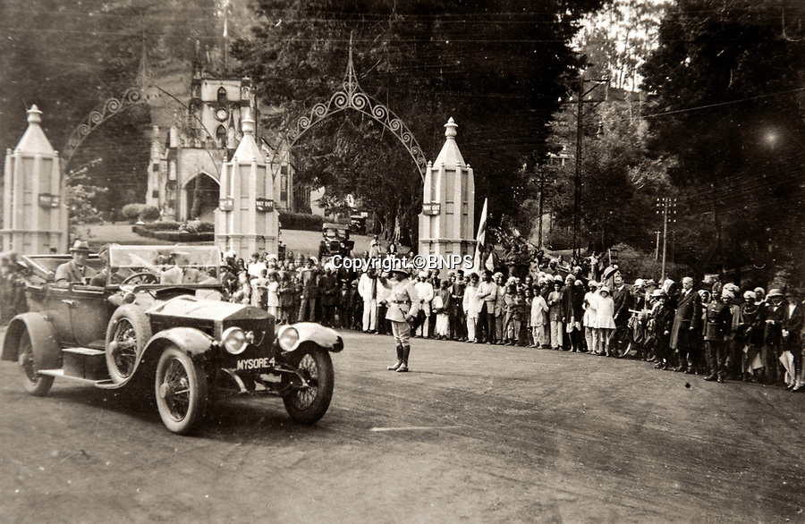 BNPS.co.uk (01202 558833)<br /> Pic: PhilYeomans/BNPS<br /> <br /> Flying the flag- Lord and Lady Goschen in a Rolls Royce loaned by the Maharaja of Mysore.<br /> <br /> Last Days of the Raj - A fascinating family album from one of the last Viceroy's of India reveal Britain's 'Jewel in the Crown' in all its splendour.<br /> <br /> The family album of Viscount George Goschen has been unearthed after 90 years, and provide's an amazing snapshot of the pomp and pageantry of a wealthy and powerful British family in India in the 1920s and 30's.<br /> <br /> They show the Governor of Madras and his family enjoying a lavish lifestyle of parades, banquets and hunting and horse racing in the last decades of the Raj.<br /> <br /> At the time, Gandhi was organising peasants, farmers and labourers to protest against excessive land-tax and discrimination. <br /> <br /> The album consists of some 300 large photographs. They have remained in the family for 90 years but have now emerged for auction following a house clearance and are tipped to sell for &pound;200.