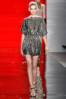 Valeriya walks runway in a ebony geometric beaded dolman-sleeved dress, from the Reem Acra Fall 2012 Feminine Power collection fashion show, during Mercedes-Benz Fashion Week New York Fall 2012 at Lincoln Center.