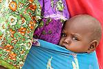 One of war's youngest victims--a baby in the Bilel camp for displaced persons.