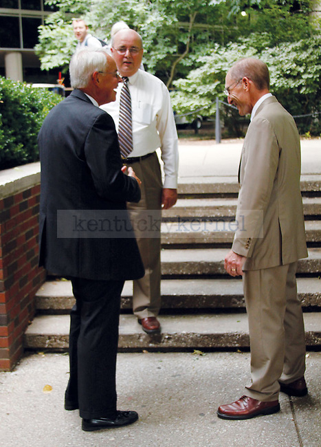 Former Kentucky Gov. Paul Patton, left, shares a laugh with new UK President Eli Capilouto, right, as Dean of Libraries Terry Birdwhistell looks on, at an informal meet and greet July 5 outside of the Student Center.