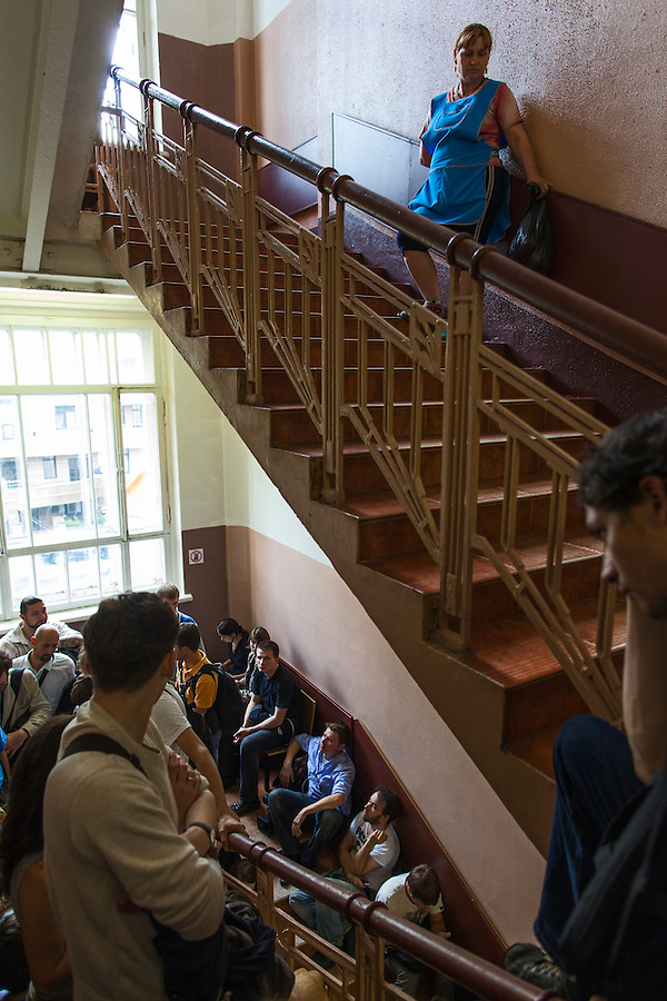 17/08/2012, Moscow, Russia..A cleaner and photographers outside the courtroom listen to the verdict being read through a loudspeaker as Maria Alyokhina, Yekaterina Samutsevich and Nadezhda Tolokonnikova of punk band Pussy Riot are sentenced to two years in prison for their performance in the Christ The Saviour Cathedral.