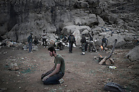 A fighter prays in a base of the Free Syrian Army in an undisclosed location on the mountains that surround Damascus. ALESSIO ROMENZI