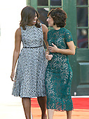 First lady Michelle Obama escorts Mrs. Agnese Landini of Italy to the Official Arrival Ceremony in honor of the visit of Prime Minister Matteo Renzi of Italy on the South Lawn of the the White House in Washington, DC on Tuesday, October 18, 2016. <br /> Credit: Ron Sachs / CNP