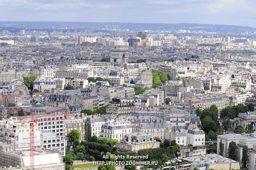 Paris cityscape with white buildings, rooftops and Triumphant Arc