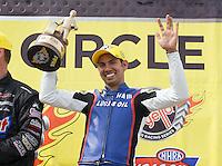 Apr. 28, 2013; Baytown, TX, USA: NHRA pro stock motorcycle rider Hector Arana Jr celebrates after winning the Spring Nationals at Royal Purple Raceway. Mandatory Credit: Mark J. Rebilas-