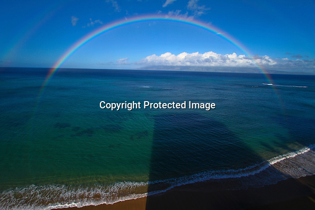A rainbow at sunrise on the western coast of Maui, Hawaii, near Kahana Beach  north of Lahaina. <br /> Jim Urquhart/Strayighteffect.com<br /> 11/16/2009