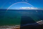 A rainbow at sunrise on the western coast of Maui, Hawaii, near Kahana Beach  north of Lahaina. <br />