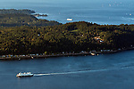 Aerial view of Ferry boats on Puget Sound one leaving Bainbridge Island the other heading toward Bremerton