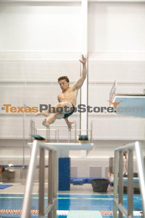 Sean O'Brien competes in the 1 meter dive...UT Men's Swimming Orange v White Meet