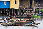"""Ganvie, Benin, with some 3,000 stilted buildings and a population of 20,000-30,000 people, may be the largest """"lake vllage"""" in Africa.  In Ganvie, the population lives exclusively from fishing, building houses on stilts in and next to Lake Nokoue.  Because the Dan-Homey religion prohibited attacks on communities living in the water, the village of Ganvie dates back to the 16th or 17th century, when it was built to protect people from slavery.  Even Ganvie's fruit and vegetable market is on water!!!"""