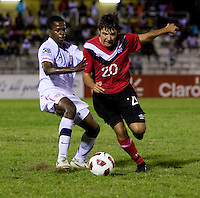 Joseph Amon (12) of the United States tries to stop Michael Petrasso (20) of Canada during the finals of the CONCACAF Men's Under 17 Championship at Catherine Hall Stadium in Montego Bay, Jamaica. The United States defeated Canada, 3-0, in overtime