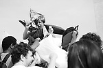 A participant in International Pillow Fight Day takes a pounding while sitting on the shoulder of another participant on The National Mall in Washington, DC on Saturday, April 3, 2010.