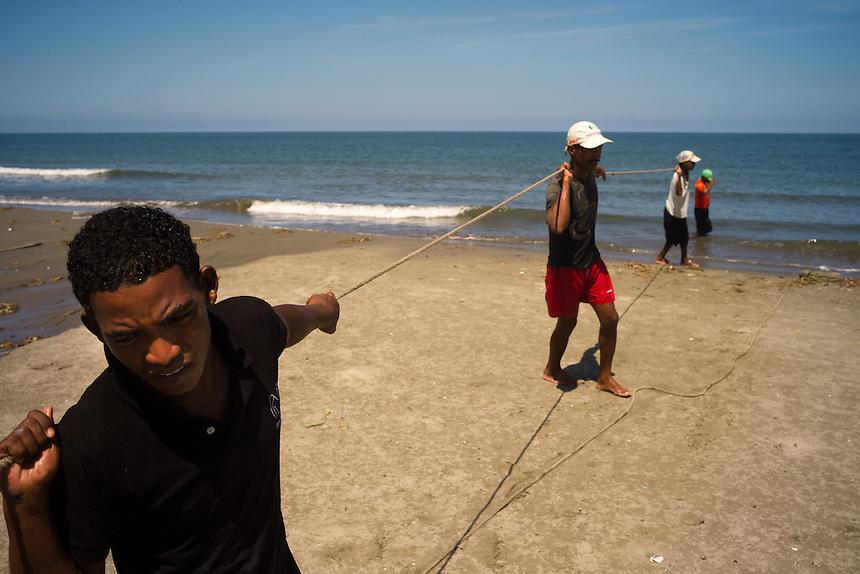 Fishermen drag net lines ashore along the Caribbean beaches near Cartagena, Colombia.