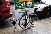 """Green party campaign poster, bicycle locked to a post taht has a  """"Green Party"""" campaign poster"""
