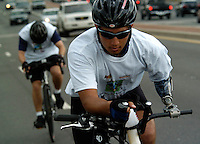 Domingo Soto, 23, rides from Annapolis to Washington, DC with his &quot;blue lightening&quot; prosthetic clamped to the handle bar of his bike. Soldier Ride cyclist are riding across the country in hopes of raising public awareness and support for the needs of the severely injured servicemen and women injured in the current military conflicts around the world. May, 13, 2006 . (James J. Lee / Army Times Staff).