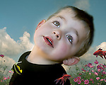 A young boy with a happy expression day dreaming with tropical fish and flowers