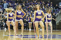 DEC 22, 2015:  Washington cheerleader Katherine Grimm entertained fans during a TV timeout in the game against Seattle University. Washington defeated Seattle University 79-68 at Alaska Airlines Arena in Seattle, WA.