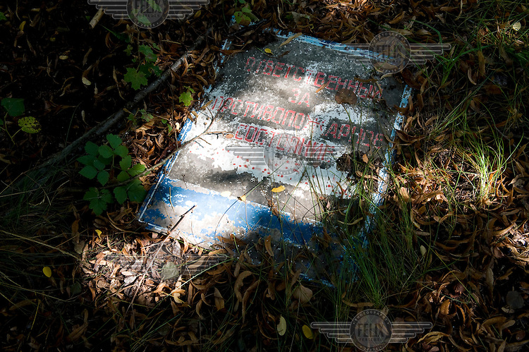 """Old Russian signs litter the ground around the """"Forbidden Town"""", a restricted area that was used by the Soviet Union from within the GDR until 1994...."""