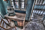 Abandoned lunatic asylum north of Berlin, Germany. Cash till on desk beside chair.