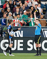 Referee Andrew Chapin gives a yellow card to Bobby Convey of Earthquakes for a tactical foul during the first half of the game against the Red Bull at Buck Shaw Stadium in Santa Clara, California.  San Jose Earthquakes defeated New York Red Bulls, 4-0.