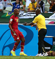 Andre Ayew of Ghana celebrates scoring his goal to make the score 1-1 with coach James Appiah