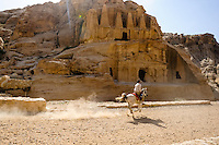 Petra is Jordan's most visited tourist attraction. Ruins close to the Siq entrance. Horse rider.