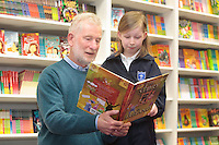 """*** NO FEE PIC***.01/03/2012.Pictured is Irish Author Brendan O' Brien with third class pupil Lucy Hand (9) from Holy Cross National School Dundrum, Dublin at a free reading event of his book """" The Story of Ireland"""" in Eason Dundrum to celebrate the 15th annual World Book Day. To celebrate World Book Day Eason, Ireland's leading retailerof books, stationery, magazines & More have teamed up with some of Ireland'sleading children's writers to deliver a series of events in key stores to mark World Book Day..Photo: Gareth Chaney Collins"""