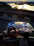 May 13, 2003 - (LtoR)  Karen Lewallen and Jacob Sentzsch take in the sunset and view atop her car at Crown Point along the Columbia River east of Portland, Oregon. The scenic highway road is popular with drivers, motorcyclists and bicyclists due to the dramatic views and curvy roads.