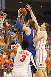 UK junior guard Jon Hood jumps to shoot the ball against heavy UF defense during the second half of the University of Kentucky vs. University of Florida men's basketball game at the O'Connell Center in Gainesville, Fl., on Tuesday, February 12, 2013. UK lost 69-52. Photo by Tessa Lighty | Staff