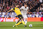 Karim Benzema (r) of Real Madrid fights for the ball with Sokratis Papastathopoulos of Borussia Dortmund during the 2016-17 UEFA Champions League match between Real Madrid and Borussia Dortmund at the Santiago Bernabeu Stadium on 07 December 2016 in Madrid, Spain. Photo by Diego Gonzalez Souto / Power Sport Images